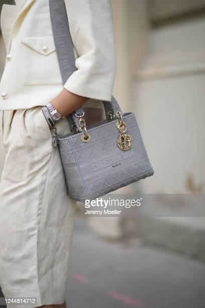 Karin Teigl wearing Arket pants, Dior bag, Chanel jacket on May 31, 2020 in Augsburg, Germany.