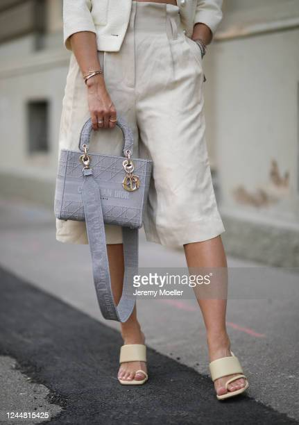 Karin Teigl wearing Arket pants, Dior bag, Zara heels, Chanel jacket on May 31, 2020 in Augsburg, Germany.