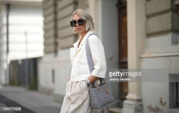 Karin Teigl wearing Arket pants, Dior shades, chain and bag, Zara bra, Chanel jacket on May 31, 2020 in Augsburg, Germany.