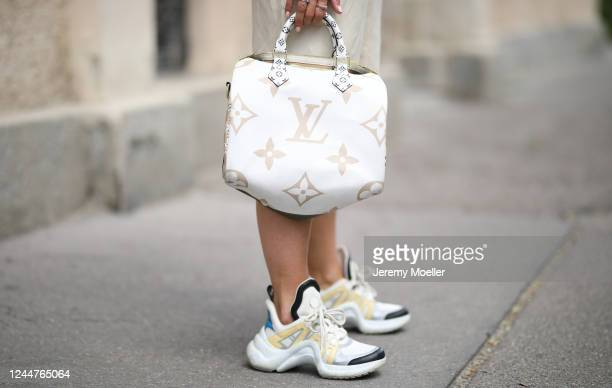 Karin Teigl wearing Arket pants, Louis Vuitton Archlight sneaker and bag on May 31, 2020 in Augsburg, Germany.