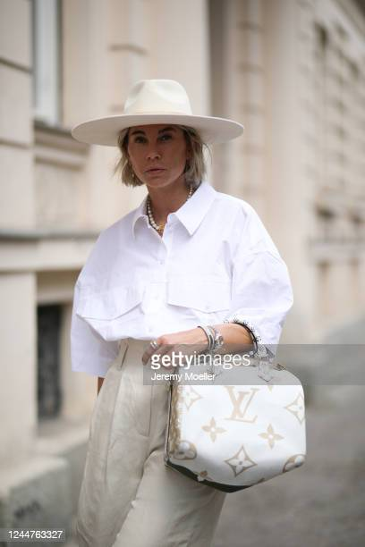 Karin Teigl wearing Arket pants, Louis Vuitton bag, Weekday shirt and Lack of Colors hat on May 31, 2020 in Augsburg, Germany.