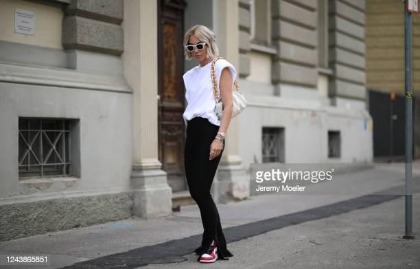 Karin Teigl wearing Bottega Veneta bag, Dior chain and shades, Monki shirt, Zara pants and Nike Air Jordan sneaker on May 31, 2020 in Augsburg,...