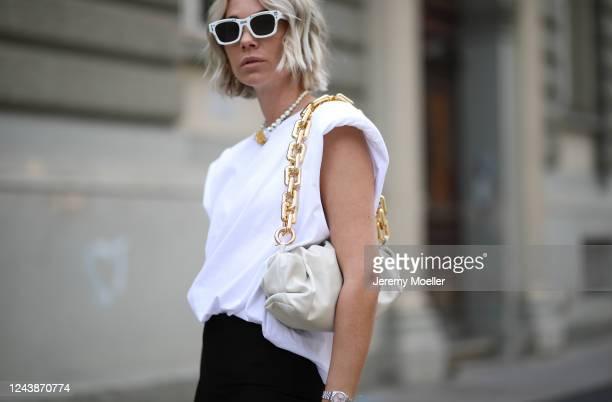 Karin Teigl wearing Bottega Veneta bag Dior chain and shades Monki shirt and Zara pants on May 31 2020 in Augsburg Germany