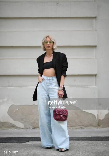 Karin Teigl wearing Bottega Veneta heels, Chanel bag, Closed jeans, Valentino shades, Skims bra, Zara blazer and Swarovski chain on May 31, 2020 in...