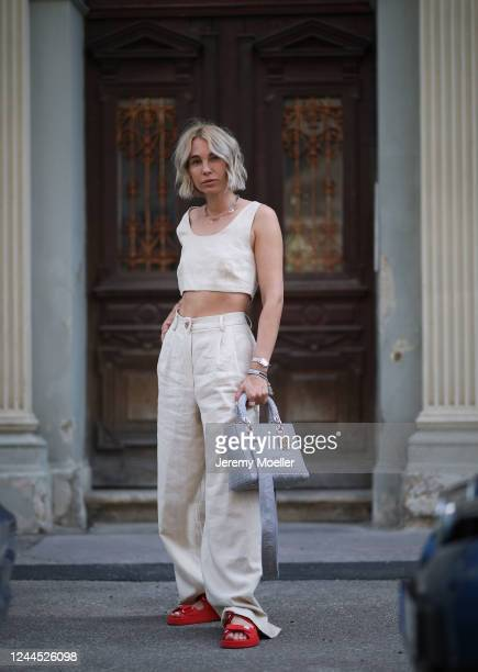 Karin Teigl wearing by Aylin Koenig pants and top, Dior bag and Chanel sandals on May 31, 2020 in Augsburg, Germany.