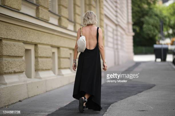 Karin Teigl wearing Chanel sandals and shades, by Aylin Koenig dress and Bottega Veneta bag on May 31, 2020 in Augsburg, Germany.