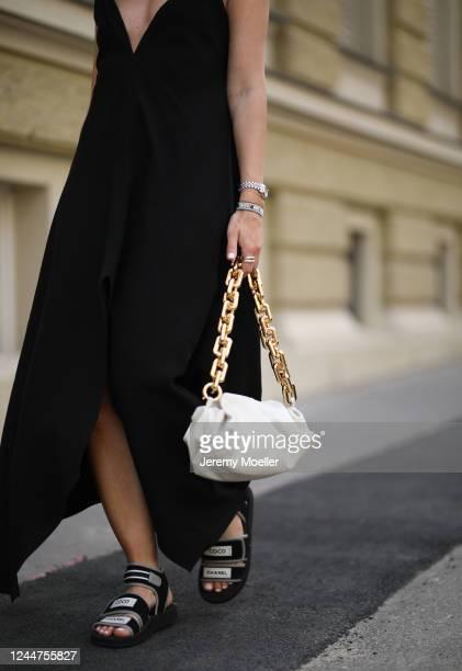 Karin Teigl wearing Chanel sandals, by Aylin Koenig dress and Bottega Veneta bag on May 31, 2020 in Augsburg, Germany.