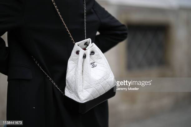 Karin Teigl wearing Closed jeans, Chanel bag, CYK by constantly k blazer, glasses carrera, drop top versace on March 25, 2019 in Augsburg, Germany.