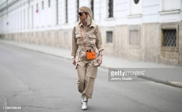 Karin Teigl wearing frankie Shop suit Isabel Marant boots Fendi bag Tommy Hilfiger sunglasses on March 25 2019 in Augsburg Germany