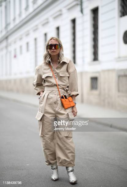Karin Teigl wearing frankie Shop suit, Isabel Marant boots, Fendi bag, Tommy Hilfiger sunglasses on March 25, 2019 in Augsburg, Germany.