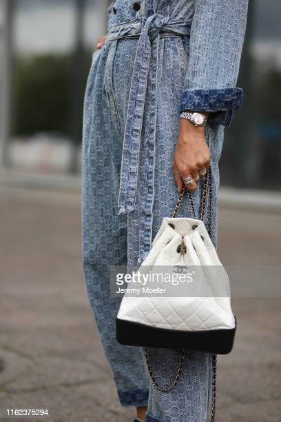 Karin Teigl wearing Gucci jeans suit, Chanel backpack and shoes on July 03, 2019 in Berlin, Germany.