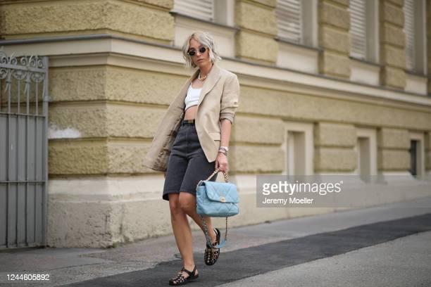 Karin Teigl wearing Gucci sandals, H&M blazer, Chanel bag, Arket jeans short, Skims shirt on May 31, 2020 in Augsburg, Germany.