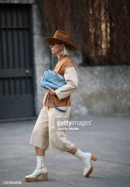 Karin Teigl wearing H&M Studio collection boots and a Chanel blue bag during Milan Fashion Week Fall/Winter 2020-2021 on February 19, 2020 in Milan,...