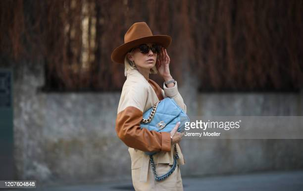 Karin Teigl wearing HM Studio collection boots and a Chanel blue bag during Milan Fashion Week Fall/Winter 20202021 on February 19 2020 in Milan Italy