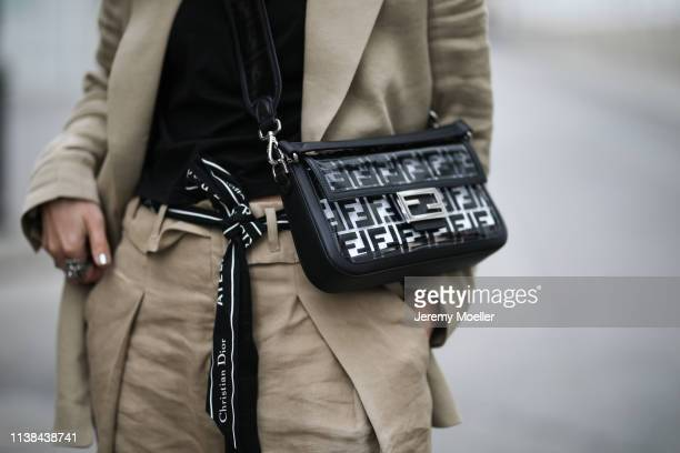 Karin Teigl wearing HM studio collection ss19 suit Fendi bag CYK by constantly k shirt Gucci and Pandora rings Cartier bracelet Rolex watch on March...