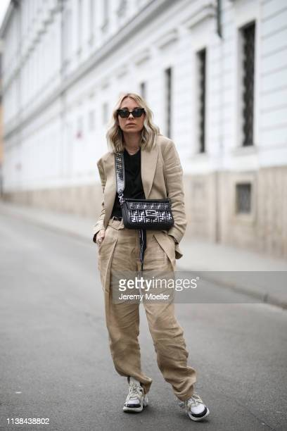 Karin Teigl wearing HM studio collection ss19 suit Fendi bag CYK by constantly k shirt Gucci and Pandora rings Cartier bracelet Rolex watch Saint...