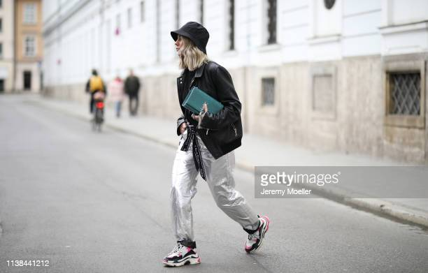 Karin Teigl wearing Isabel Marant pants, Balenciaga Triple S sneaker, Christian Dior belt, Saint Laurent bag, andotherstories hat and Dior jacket on...