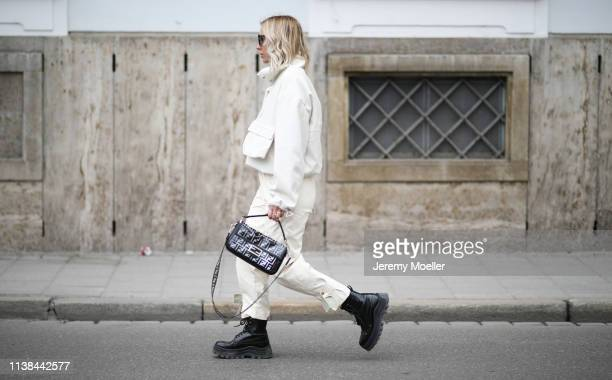 Karin Teigl wearing top and pants from Frankie shop hm x eytys boots bag fendi on March 25 2019 in Augsburg Germany