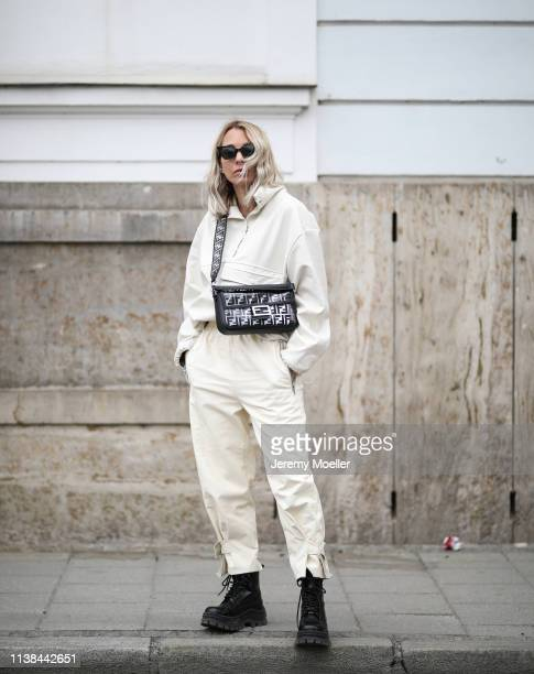 Karin Teigl wearing top and pants from Frankie shop, hm x eytys boots, bag fendi on March 25, 2019 in Augsburg, Germany.