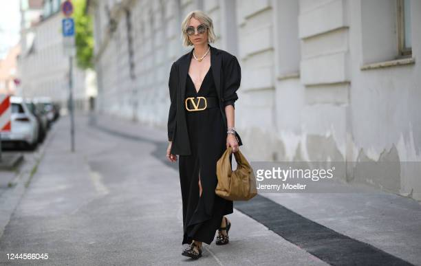 Karin Teigl wearing Valentino belt, by Aylin Koenig dress, Zara blazer, Gucci sandals and shades and Bottega Veneta bag on May 31, 2020 in Augsburg,...