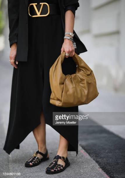 Karin Teigl wearing Valentino belt, by Aylin Koenig dress, Zara blazer, Gucci sandals and Bottega Veneta bag on May 31, 2020 in Augsburg, Germany.