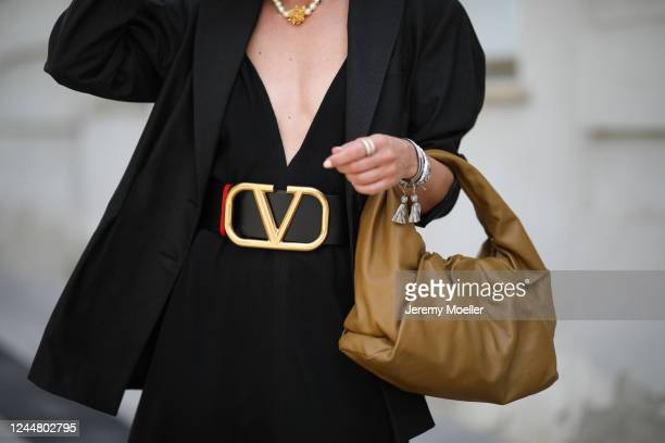 Karin Teigl wearing Valentino belt, by Aylin Koenig dress, Zara blazer and Bottega Veneta bag on May 31, 2020 in Augsburg, Germany.