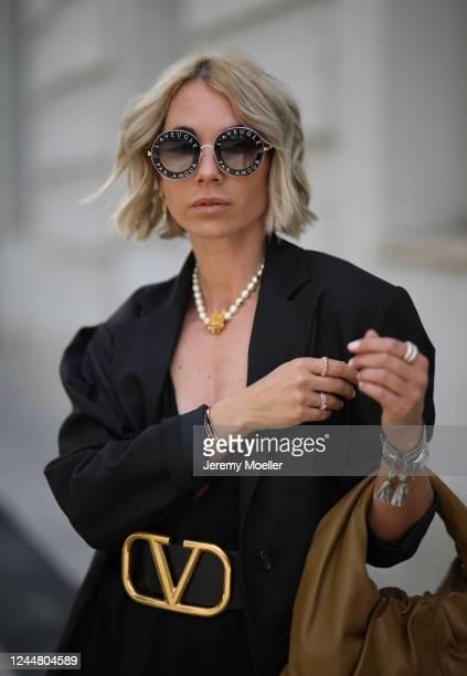 Karin Teigl wearing Valentino belt, by Aylin Koenig dress, Zara blazer, Gucci shades and Bottega Veneta bag on May 31, 2020 in Augsburg, Germany.