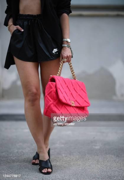 Karin Teigl wearing Zara blazer, Nike short, YSL heels and Chanel bag on May 31, 2020 in Augsburg, Germany.