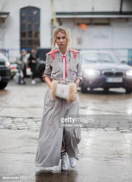 Karin Teiglwearing high waisted pants military jacket is seen outside Marina Hoermanseder during the Berlin Fashion Week January 2018 on January 18...