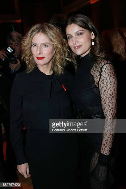 Karin Viard and Laetitia Casta attend the Sidaction Gala Dinner 2017 Haute Couture Spring Summer 2017 show as part of Paris Fashion Week on January...