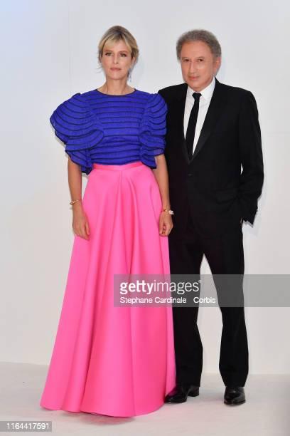 Karin Viard and Michel Drucker attend the 71th Monaco Red Cross Ball Gala on July 26 2019 in Monaco Monaco