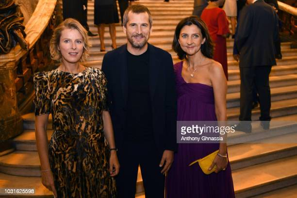 Karin Viard Guillaume Canet and Sophie Delafontaine attend Longchamp 70th Anniversary Celebration at Opera Garnier on September 11 2018 in Paris...