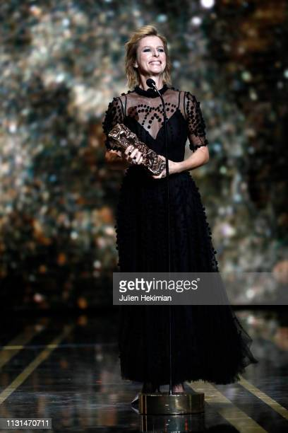 """Karin Viard poses with the Best Supporting Actress Award for """"Les Chatouilles"""" during the Cesar Film Awards 2019 at Salle Pleyel on February 22, 2019..."""