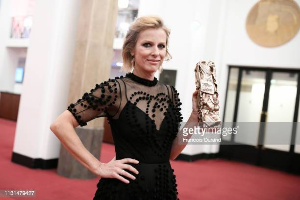 Karin Viard poses with the Cesar for Best Actress in a Supporting Role award for the film 'Les Chatouilles' during the Cesar Film Awards 2019 at...