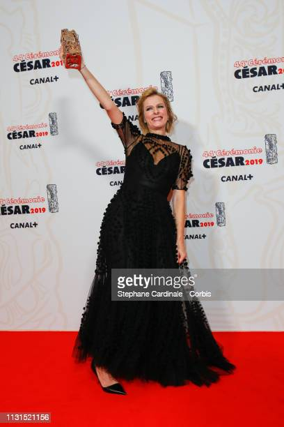 Karin Viard poses with the Cesar for Best Actress in a Supporting Role award for the film 'Les Chatouilles' during the 44th Cesar Awards Ceremony at...