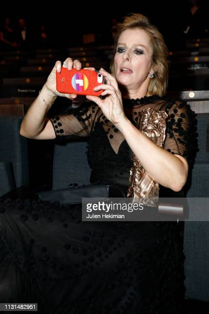 Karin Viard takes a selfie with her Best Suporting Actress award during the Cesar Film Awards 2019 at Salle Pleyel on February 22 2019 in Paris France
