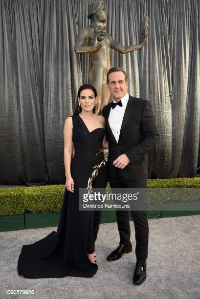 Karina Banda and Carlos Ponce attend the 25th Annual Screen ActorsGuild Awards at The Shrine Auditorium on January 27 2019 in Los Angeles California...