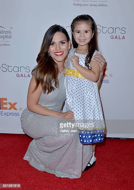 Karina Banda and St Jude Patients Crista Anleu attends the FedEx / St Jude Angels and Stars Gala at Hotel InterContinental on May 14 2016 in Miami...