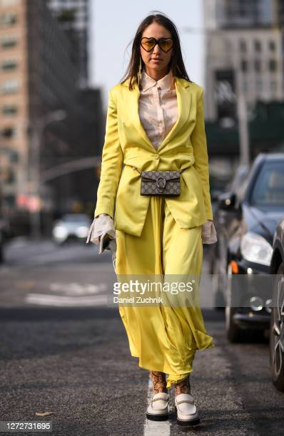 Karina Bik is seen wearing a yellow jacket and skirt, light pink shirt, cream shoes and a Gucci bag outside the Rebecca Minkoff show during New York...
