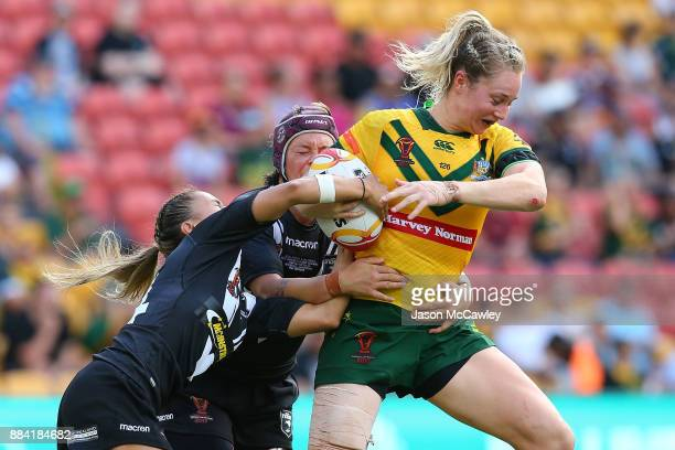 Karina Brown of the Jillaroos is tackled during the 2017 Rugby League Women's World Cup Final between Australia and New Zealand at Suncorp Stadium on...