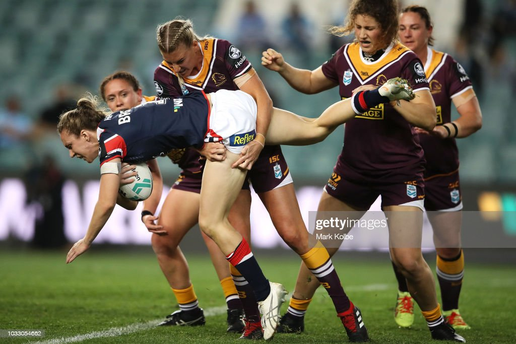 Karina Brown of the Roosters is tackled by Ali Brigginshaw of the Broncos during the round two Women's NRL match between the Sydney Roosters and the Brisbane Broncos at Allianz Stadium on September 14, 2018 in Sydney, Australia.
