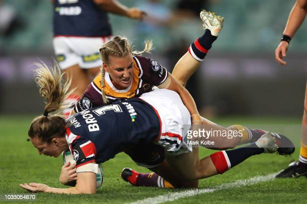 Karina Brown of the Roosters is tackled by Ali Brigginshaw of the Broncos during the round two Women's NRL match between the Sydney Roosters and the...