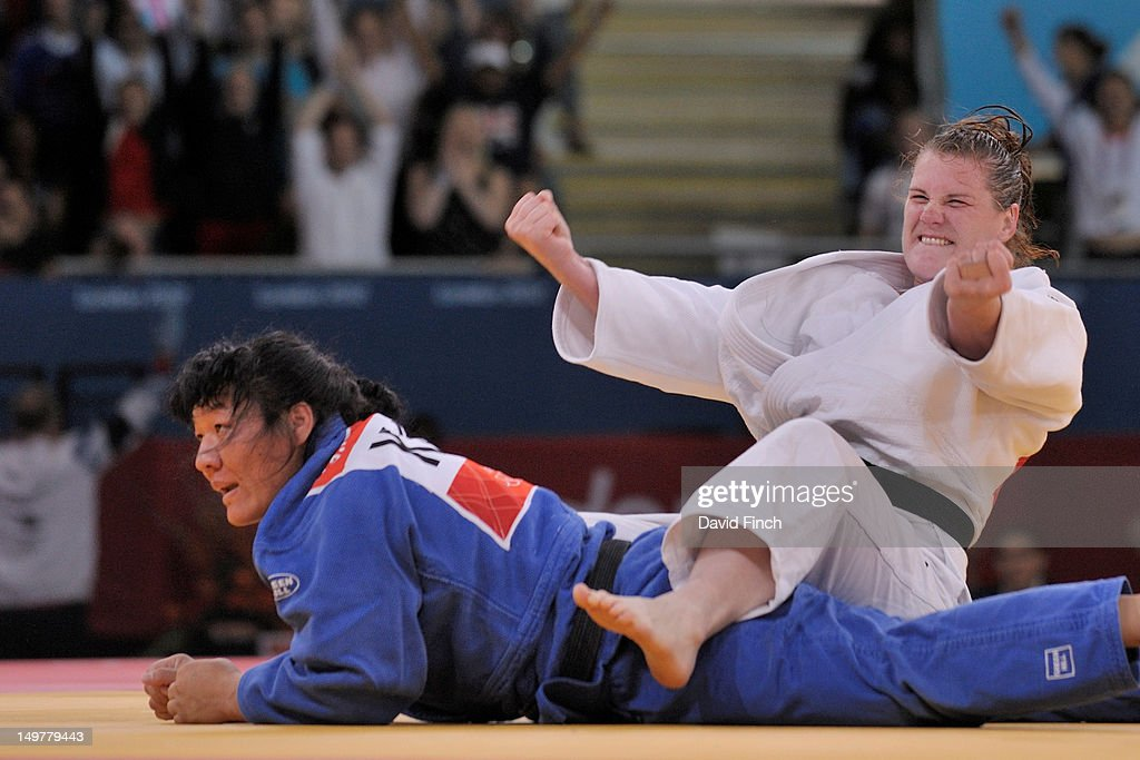 Karina Bryant of Great Britain (white) celebrates after defeating Gulzhan Issanova of Kazakstan by a wazari on her way to a bronze medal in the Women's +78 kg Judo on Day 7 of the London 2012 Olympic Games at ExCeL on August 3, 2012 in London, England.