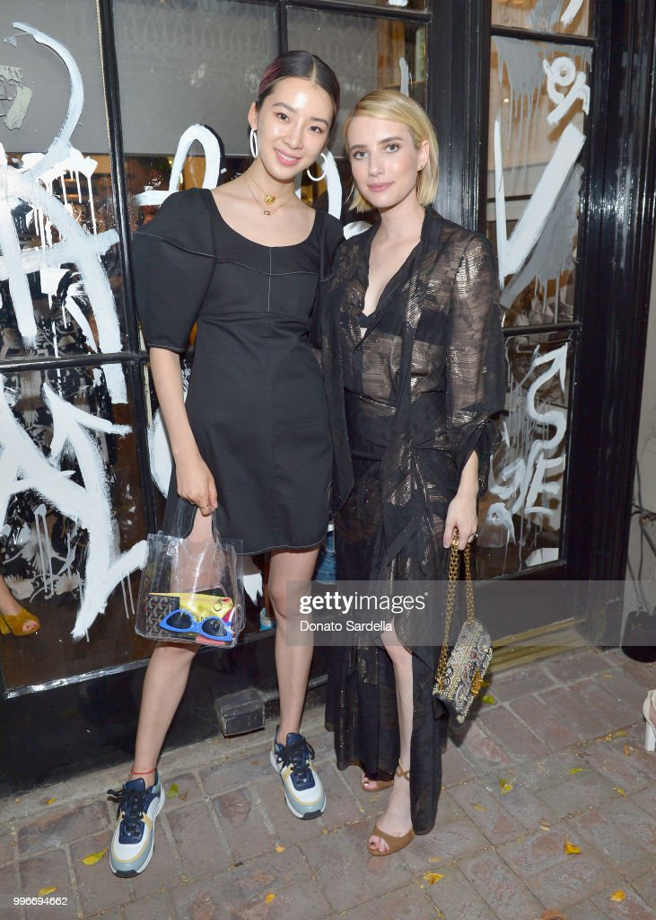 Karina Cha (L) and Emma Roberts attend Beats by Dre for VIOLET GREY Party on July 11, 2018 in Los Angeles, California.