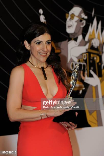 Karina Gidi poses with the Ariel Award after winning Best Actress for 'The Eternal Feminine' during 60th Ariel Awards at Palacio de Bellas Artes on...