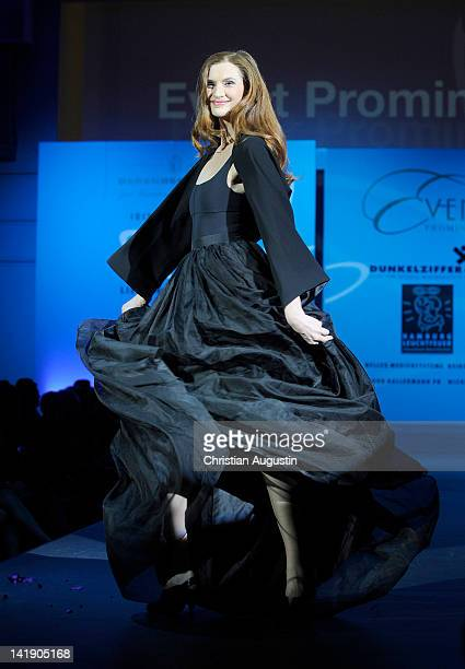Karina Krawczyk shows designs on the catwalk during the charity event Event Prominent at the Hotel Grand Elysee on March 25 2012 in Hamburg Germany