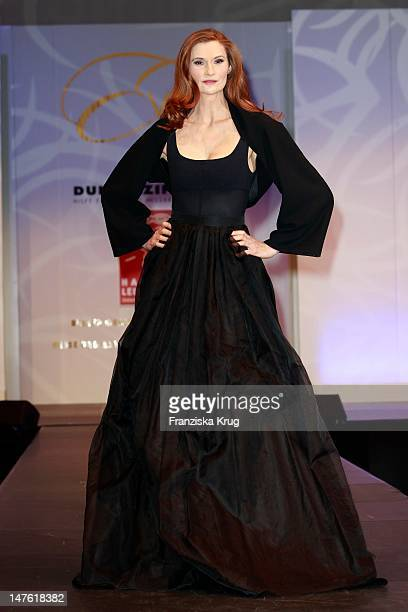 Karina Krawczyk shows designs on the catwalk during the charity event 'Event Prominent' at the Hotel Grand Elysee on March 25 2012 in Hamburg Germany