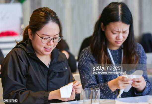 Karina Leung Kaki and Camille Wong Laiming learn how to dye handkerchiefs to be used as Christmas gift wraps during an OpSanta event in Maxims in...
