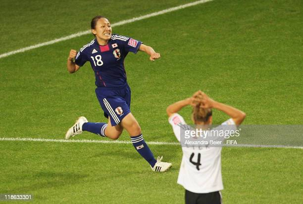 Karina Maruyama of Japan celebrates her first goal as Babett Peter of Germany reacts during the FIFA Women's World Cup quarter finals match between...
