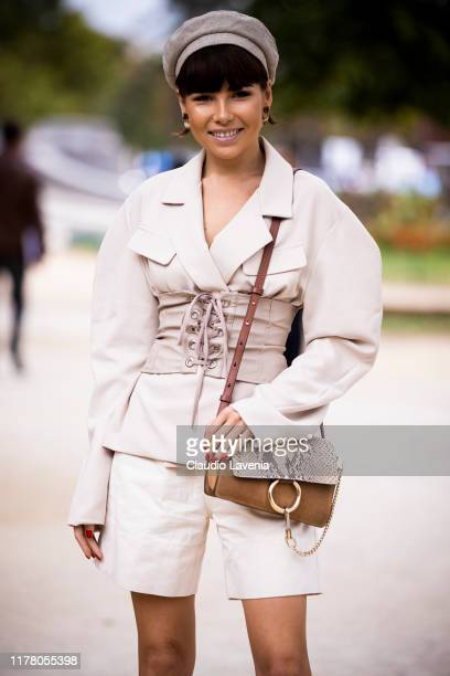 Karina Nigay wearing a cream blazer with nude belt nude shorts and Chloe bag is seen outside the Chloe show during Paris Fashion Week Womenswear...